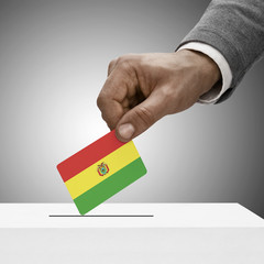 Black male holding flag. Voting concept - Bolivia