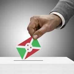 Black male holding flag. Voting concept - Burundi