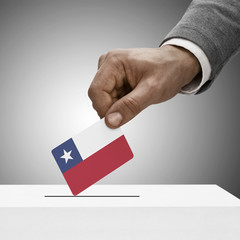 Black male holding flag. Voting concept - Republic of Chile