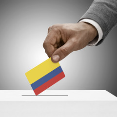 Black male holding flag. Voting concept - Colombia