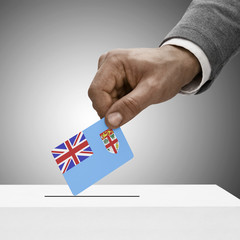 Black male holding flag. Voting concept - Fiji