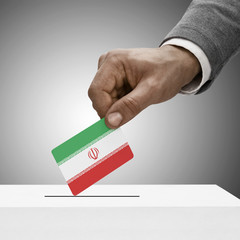Black male holding flag. Voting concept - Iran