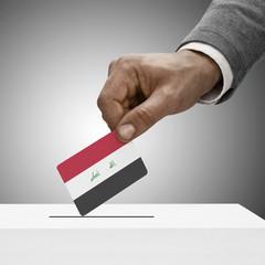 Black male holding flag. Voting concept - Iraq