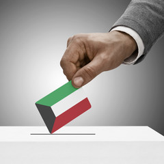 Black male holding flag. Voting concept - Kuwait