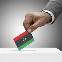 Black male holding flag. Voting concept - Libya