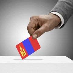 Black male holding flag. Voting concept - Mongolia
