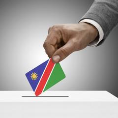 Black male holding flag. Voting concept - Namibia