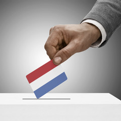 Black male holding flag. Voting concept - Netherlands