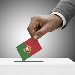 Black male holding flag. Voting concept - Portugal