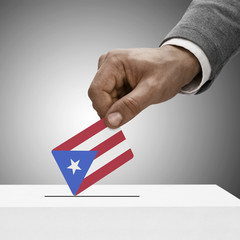Black male holding flag. Voting concept - Puerto Rico
