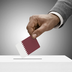 Black male holding flag. Voting concept - Qatar