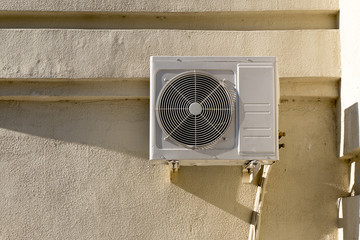 Air conditioner on the wall outdoors in summer.