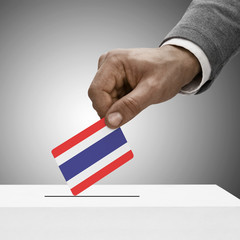 Black male holding flag. Voting concept - Thailand