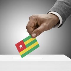 Black male holding flag. Voting concept - Togo