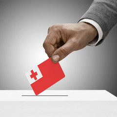 Black male holding flag. Voting concept - Tonga
