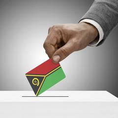 Black male holding flag. Voting concept - Vanuatu