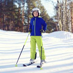 Portrait of professional skier boy dressed in sportswear
