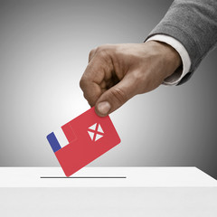 Black male holding flag. Voting concept - Wallis and Futuna