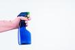 Leinwandbild Motiv human hand holding cleaning spray bottle