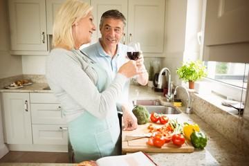 Mature couple preparing vegetables together