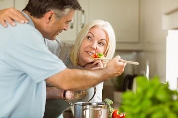 Mature couple preparing vegetarian meal together
