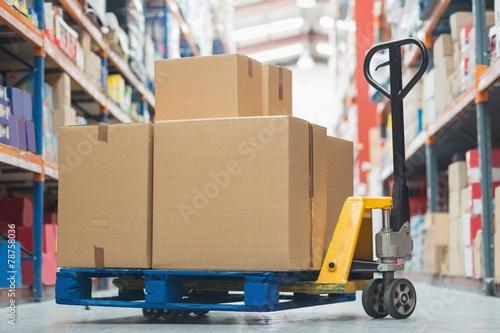 Leinwanddruck Bild Boxes on trolley in warehouse
