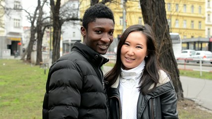 couple show thumb on agreement - black man and asian woman