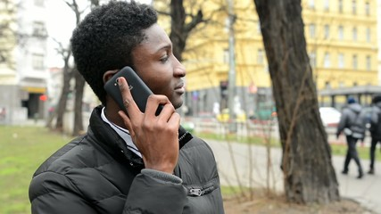 young handsome black man phone - urban street with cars - city