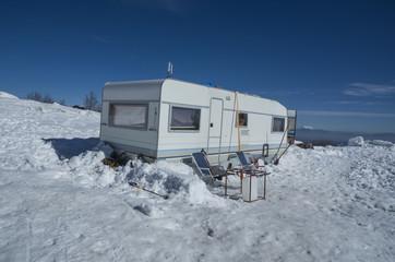 car caravan in the snow winter holidays