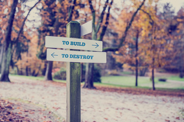 Opposite directions towards To build and To  destroy