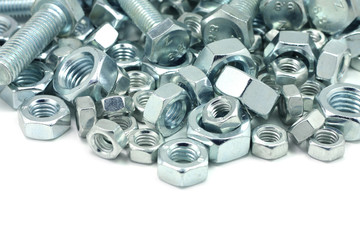 Metal bolts and nuts on a white background