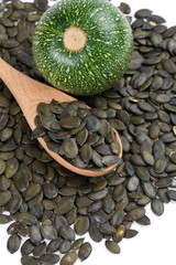 pumpkin with seeds in a wooden spoon