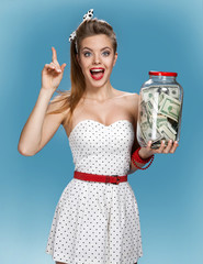 woman with a jar of money having an idea. Shopping concept