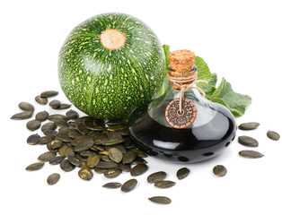 pumpkin seed oil with seeds and plant