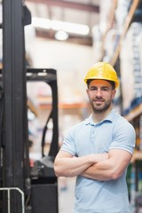 Worker wearing hard hat in warehouse