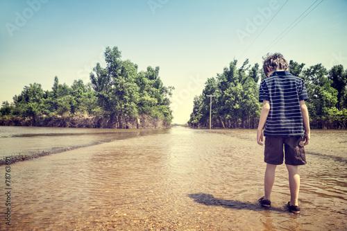 Leinwandbild Motiv Child on flooded road