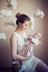 mother with baby on white clouds
