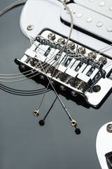 Electric guitar bridge with strings