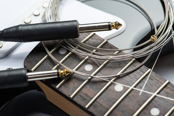 Guitar frets with strings, cable and jacks