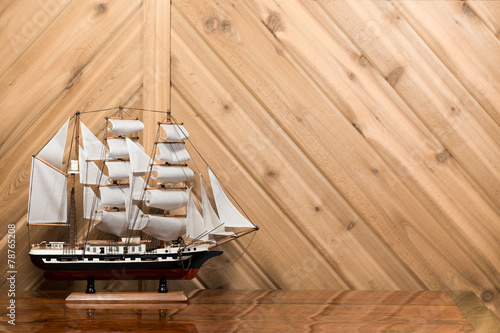 Deurstickers Zeilen Sailboat / Model Ship against Plank Wall with Copy Space