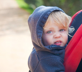 Blond baby in backpack