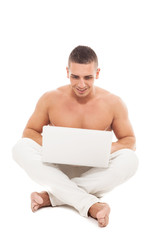 Caucasian man with nacked chest is working with notebook while s
