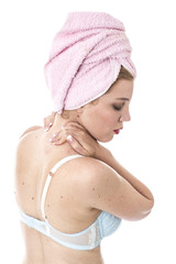 Model Released.  Young Woman with a Stiff Neck