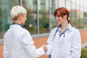 Handshake between two female doctors