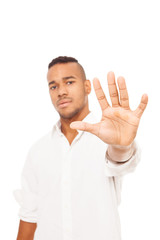 African man is making stop gesture over white isolated backgroun