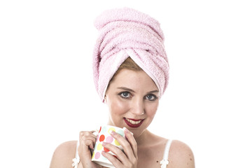 Model Released. Attractive Young Woman Drinking a Mug of Coffee