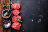 Raw fresh marbled meat Steak and seasonings on dark marble backg