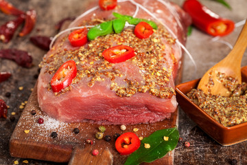 Fresh Raw meat with spices on wooden board
