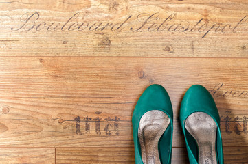 Woman shoes from above on wooden floor