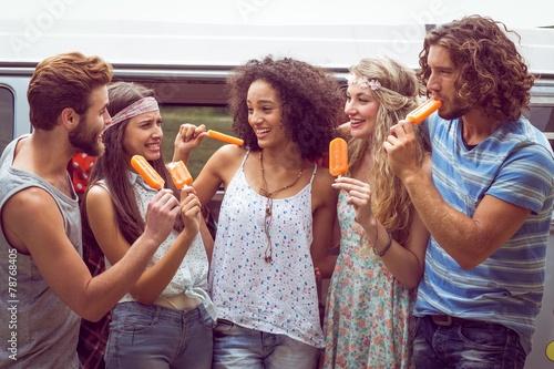 Hipster friends enjoying ice lollies - 78768405